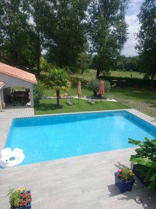 Mise en place de dallage et margelles autour d'une piscine BORDEAUX en Gironde